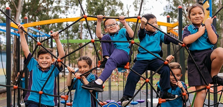 A group of young students play in a playground web.
